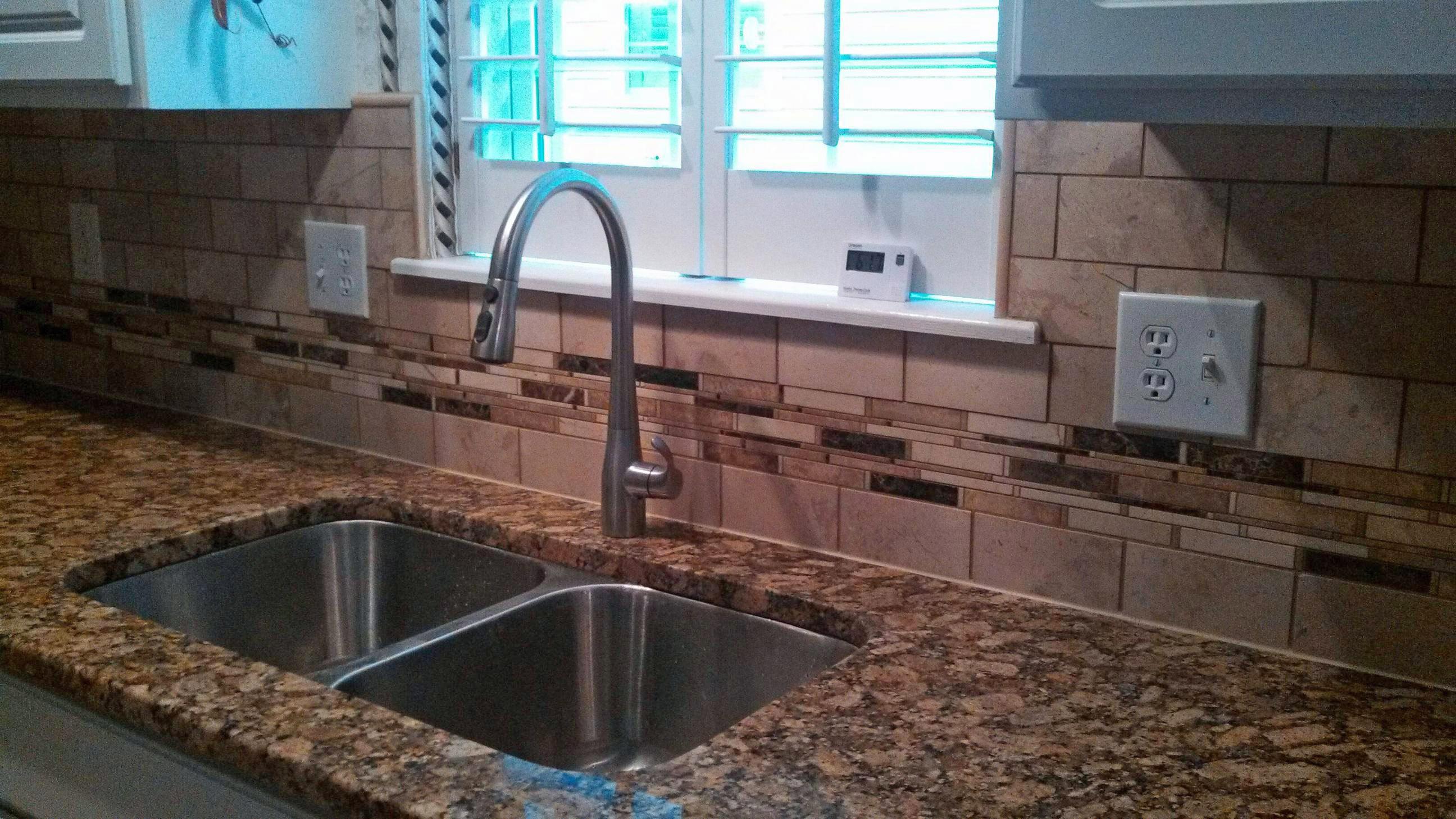 Glass tile backsplash with