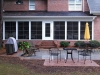 Addition with Eze-Breeze windows and concrete patio with brick pavers