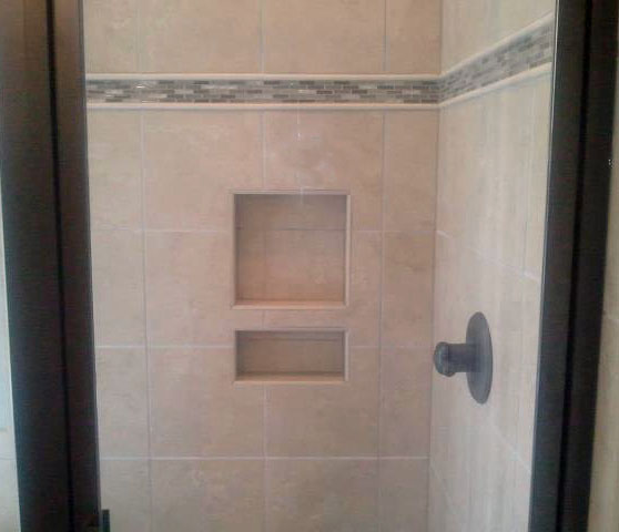 Remodeling And Renovations Tile Shower With Decorative Trim