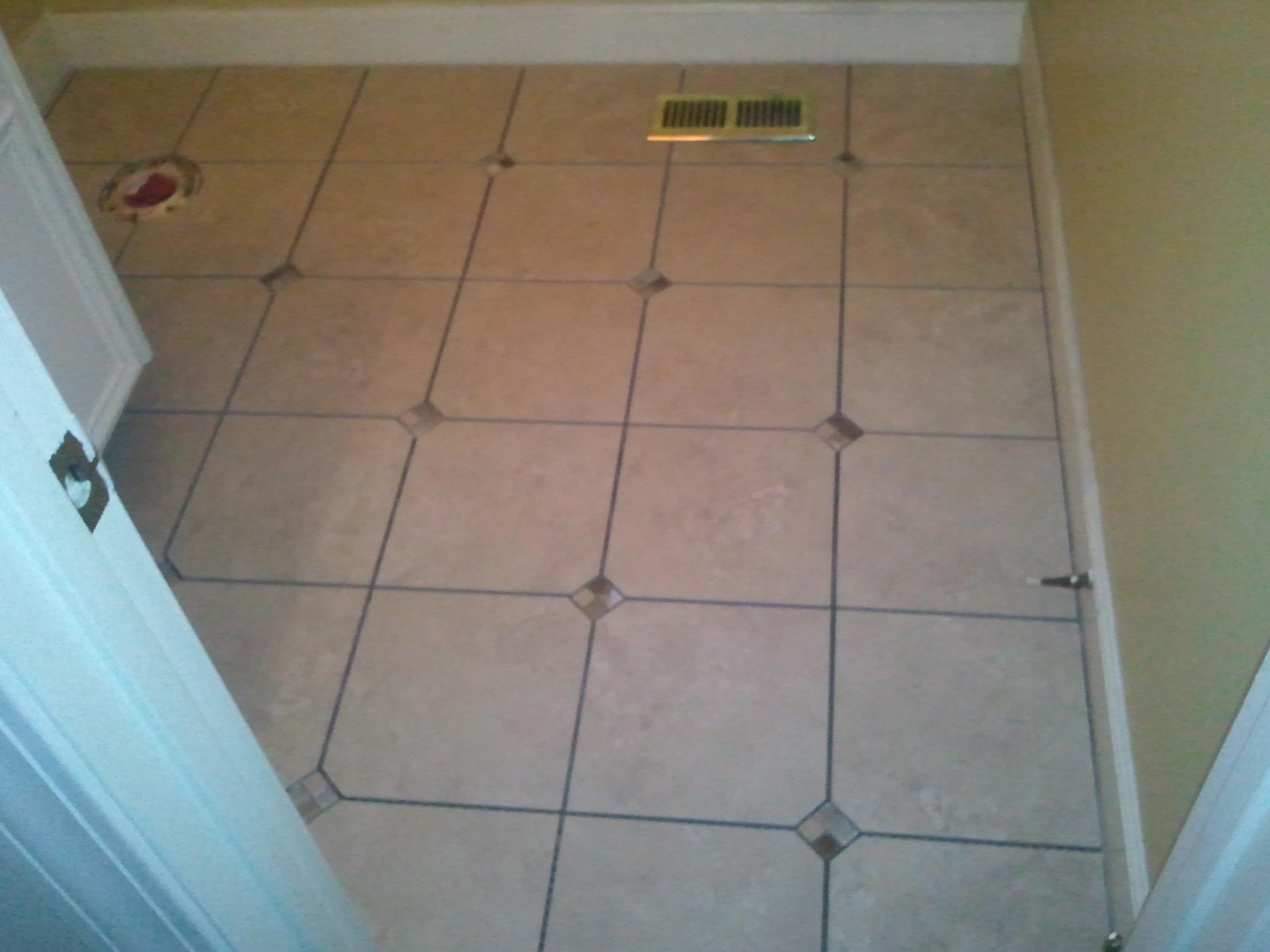 Bathroom remodel tile floor grace construction inc for Redo bathroom floor