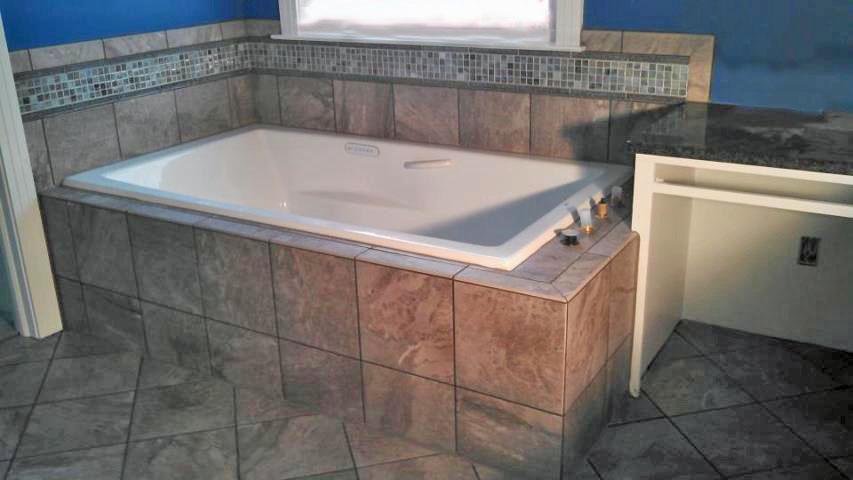 Tub surround with accent tile | Grace Construction, Inc.